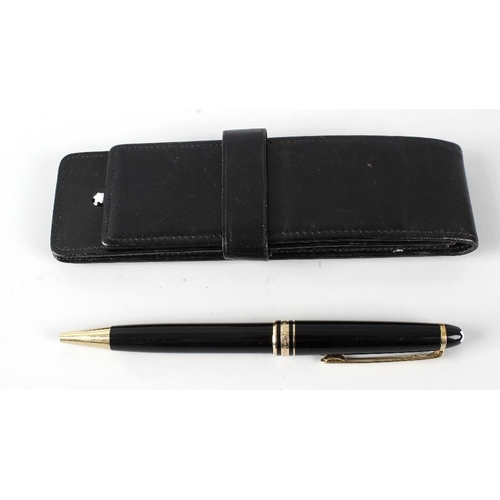 142 - A Montblanc Meisterstuck ballpoint pen, having black resin body, gold coloured banding and Montblanc...