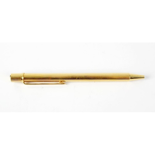 151 - A gold plated Must de Cartier ballpoint pen, the ribbed body with Cartier emblem to plain clip, 5 (1...