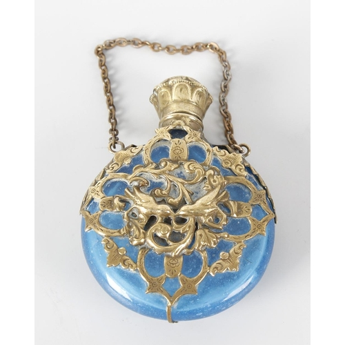 16 - A Victorian circular blue glass bodied scent bottle with hinged cover and fitted suspension chain, t...
