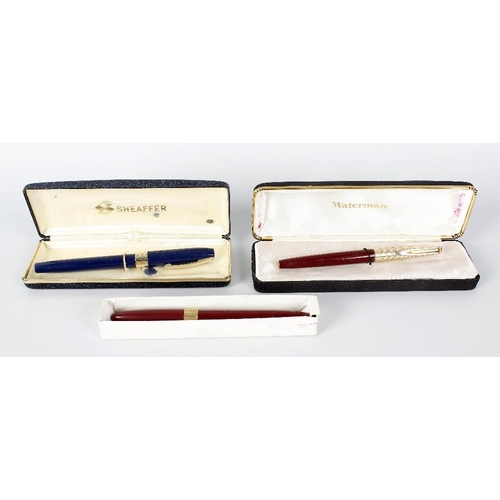 166 - A Sheaffer fountain pen, the blue coloured body with plated pen clip and band to removable top, lift...