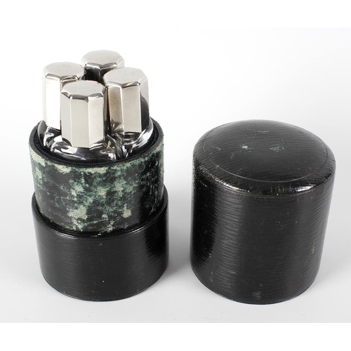 17 - An early 20th century cased set of scent bottles, the outer green leather covered cylindrical case w...