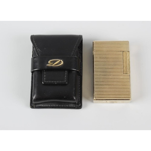 170 - A S T Dupont gold plated lighter, of rectangular form with ribbed horizontal decoration, 2.25 (5.5cm...