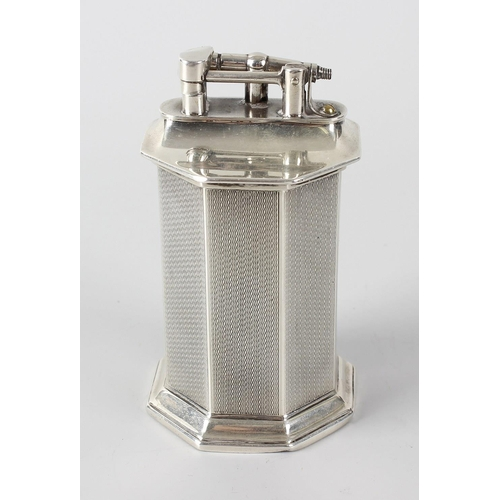 172 - A hallmarked silver cigarette lighter, of octagonal pedestal form upon a footed base, the body with ...