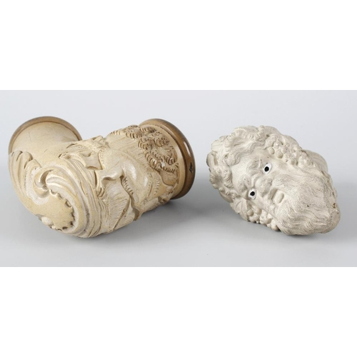 175 - Two carved meerschaum pipe bowls, the first modelled with a gundog in a landscape, 3.25, (8cm) high,...