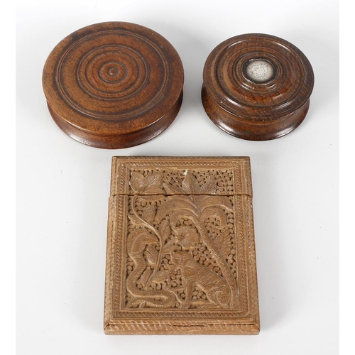 180 - A 19th century turned oak snuff box and cover, inset with a white metal panel detailed 'Fragment of ...