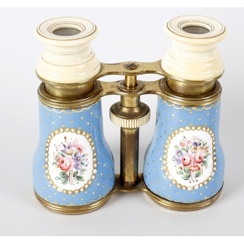 181 - A pair of 19th century ivory, gilt metal and enamel opera glasses, the floral decorated panels withi...