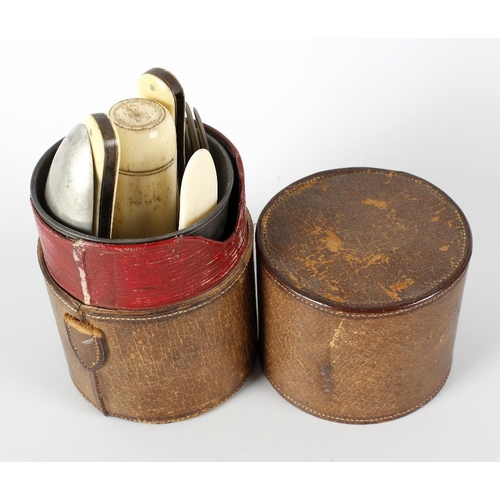 192 - A 19th century campaign style leather cased travel set, the cylindrical leather case with removable ...