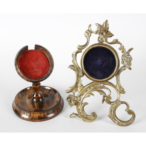198 - A 19th century brass scroll shaped pocket watch of easel form, 6 (15.25cm) high, together with anoth...