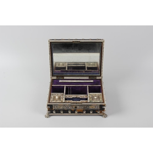 213 - An Indian Vizagapatam style tortoiseshell and ivory jewellery box c.1900, of rectangular form, havin...