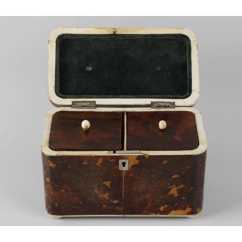 218 - An early 19th century tortoiseshell tea caddy. The rounded oblong cover, with vacant white metal car...