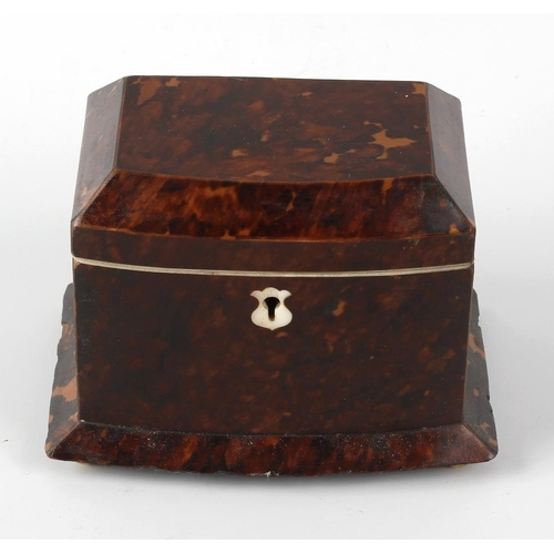 219 - A small early 19th century tortoiseshell tea caddy. The hinged bowfront cover with canted angles, en...