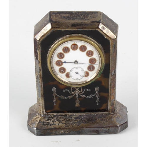 220 - An early 20th century silver and tortoiseshell boudoir clock. The 1-5-inch white dial with cellular ...