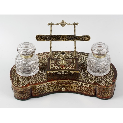 221 - A 19th century red boulle desk stand, the body of kidney shaped form, with lower drawer, two glass i...