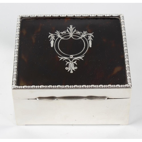 223 - A silver and tortoiseshell box, the hallmarked silver body of square form, with hinged tortoiseshell...