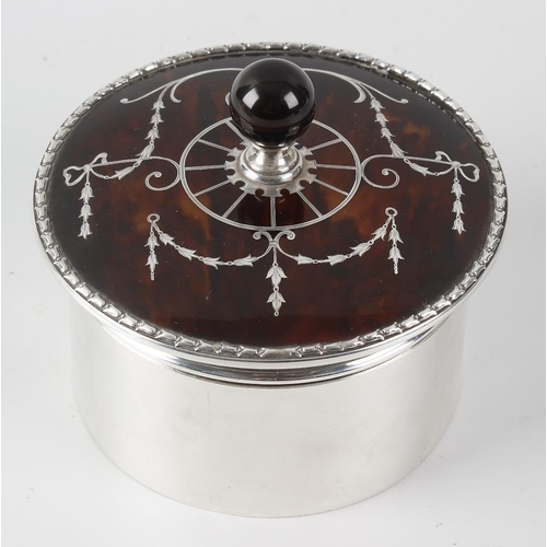 226 - A silver and tortoiseshell box, the silver body of circular form hallmarked London 1920, the tortois...