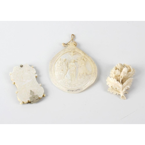 234 - A small group of collectables, comprising a carved mother of pearl pilgrim pendent, with central pan...