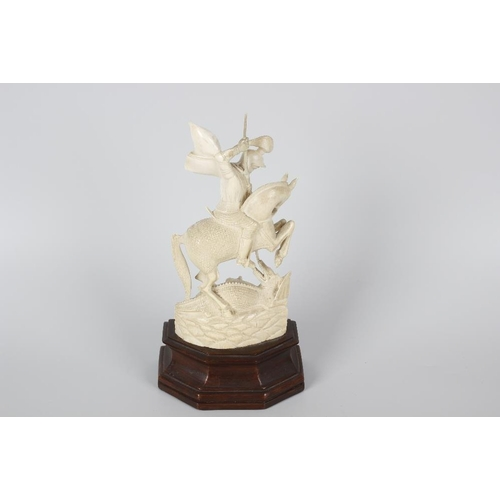 235 - An ivory figure, modelled as St George staying the dragon (s/d), raised upon stepped wooden base, fi...