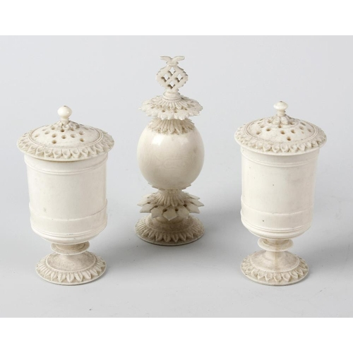 236 - Two 19th century carved and turned ivory pounce pots, each with removable cover, raised upon a turne...