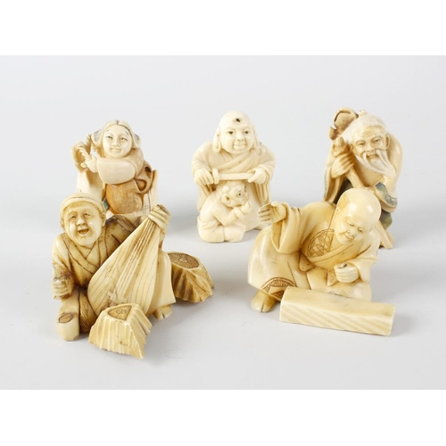 240 - A group of Japanese ivory netsuke, comprising two pairs of figures, the first pair modelled as a sag...