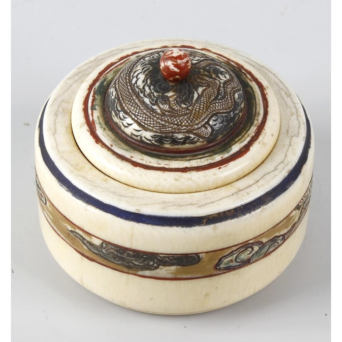 244 - A Chinese ivory box and cover, of circular form with stepped domed cover, having etched and painted ...