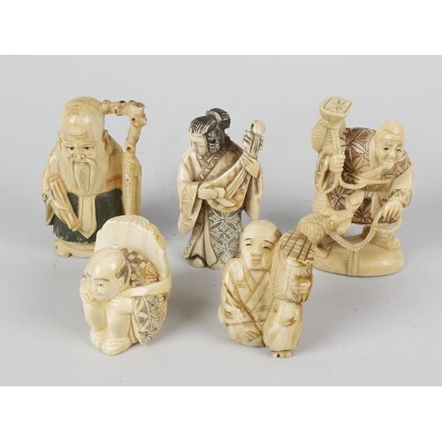 247 - Five Japanese ivory netsuke, comprising a sage, a musician, a crouching figure with mask backpack, a...