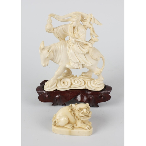 248 - A Japanese carved ivory okimono, late Meiji/Taisho period, modelled as a sage riding upon a mythical...