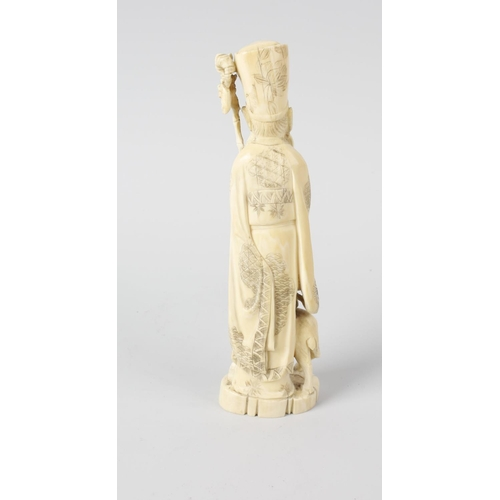 249 - A Japanese late Meiji/Taisho period carved ivory okimono, modelled as Fukurokuju, the bearded deity ...