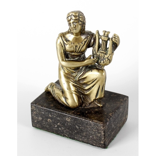 261 - A 19th century gilt bronze figure of Calliope, crouched and resting upon one knee, upon her other kn...