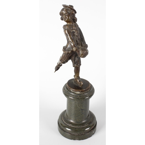 264 - A small late 19th century bronze figure modelled as a young boy ice skating, on turned pedestal stan...
