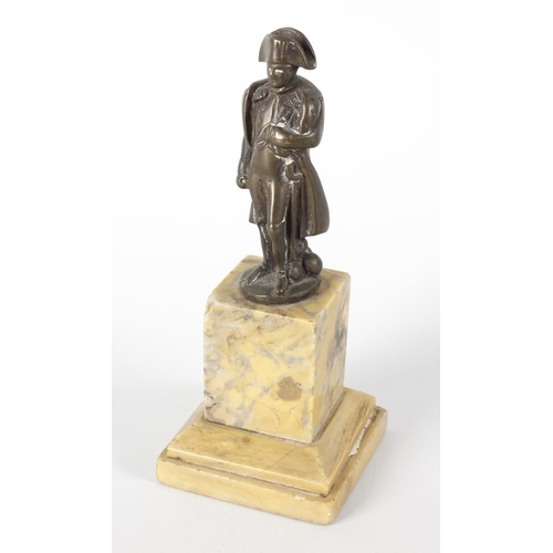 266 - A small 19th century cast bronze figure modelled as Napoleon Bonaparte dressed in full military unif...