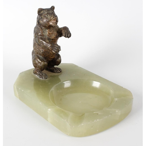 268 - An early 20th century green onyx ashtray with applied cold painted bronze figure of a bear standing ...