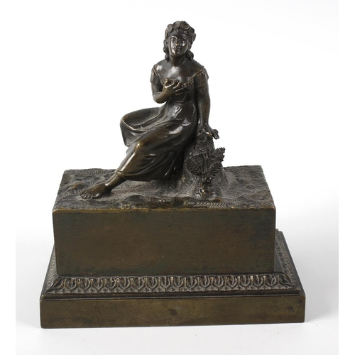 273 - A 19th century French bronze inkwell, the body of rectangular form raised upon a stepped base, the c...