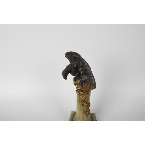 277 - A 19th century bronze and gilt bronze pocket watch stand, modelled as an eagle with outstretched win...