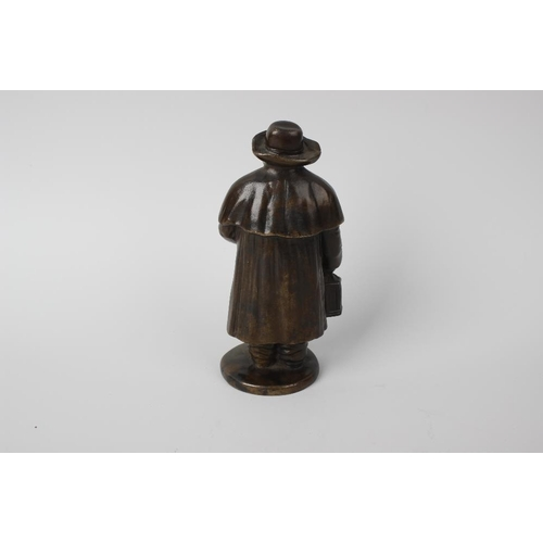 280 - A cast bronze figure of a Nightwatchman, modelled in hat, cloak and long coat, holding a lantern, on...