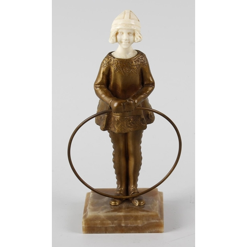 281 - Solange Bertrand, an Art Deco bronze and ivory figure modelled as a girl with a hoop, on stepped, sq...