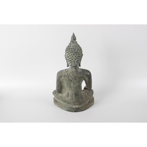 284 - An early 18th century bronze figure modelled as an eastern sukhothal style Buddha in traditional sea...