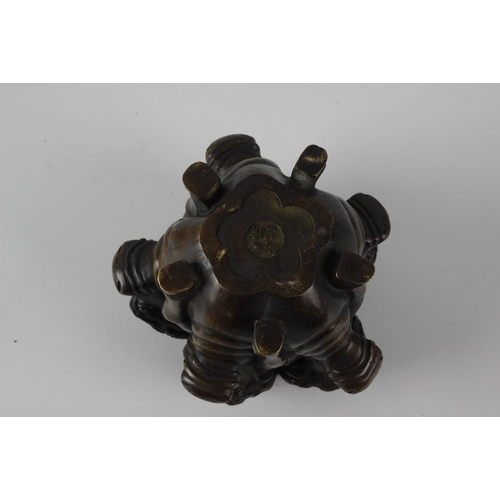289 - A Sino-Tibetan bronze incense burner and cover, the body modelled as five horned bulls facing outwar...