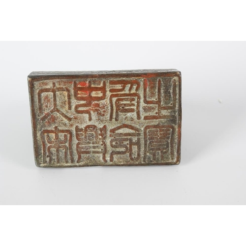 291 - An unusual Chinese bronze desk seal modelled as an elephant and attendant, upon a plinth, its unders...