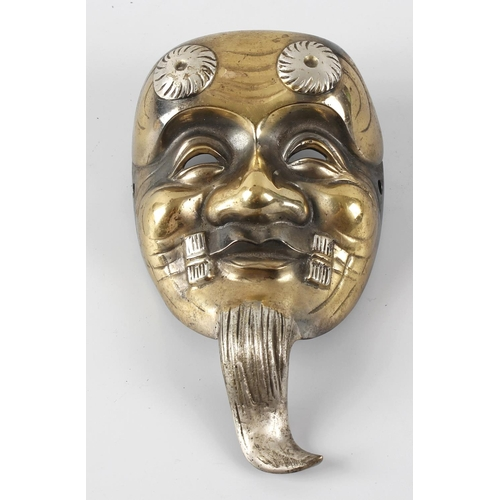 293 - A cast Japanese Noh mask, 5.75 (14.5cm) high.  <br>With general surface wear including scratches, pi...