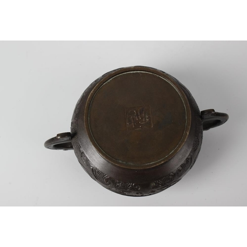 295 - A Chinese bronze incense burner of Archaistic type, the two-handled squat cauldron-form body with al...