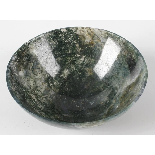 298 - A moss agate circular bowl, 5 (12.5cm) diameter. <br>Minor chips to edge and some light surface scra...
