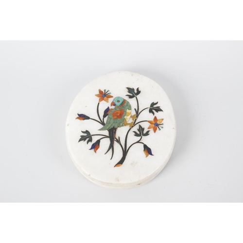 300 - A white oval marble paperweight with pietra dura inlaid decoration depicting a parrot, 5.25 (13cm) x...
