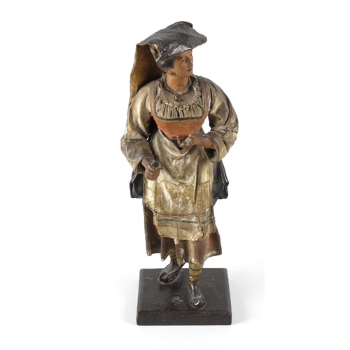 305 - An unusual painted carved wooden and painted leather covered figure, modelled as a continental peasa...