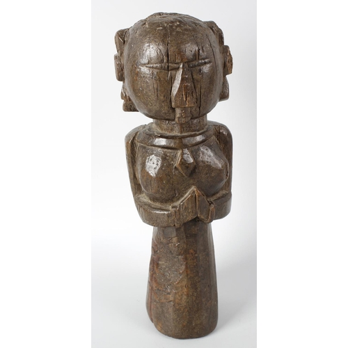 306 - An early carved ethnographic figure modelled as a female with plaited hair and carved facial feature...
