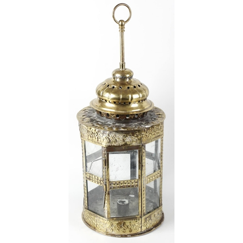 314 - A brass lantern, in the 18th century style, the cylindrical body with punched foliate design, having...