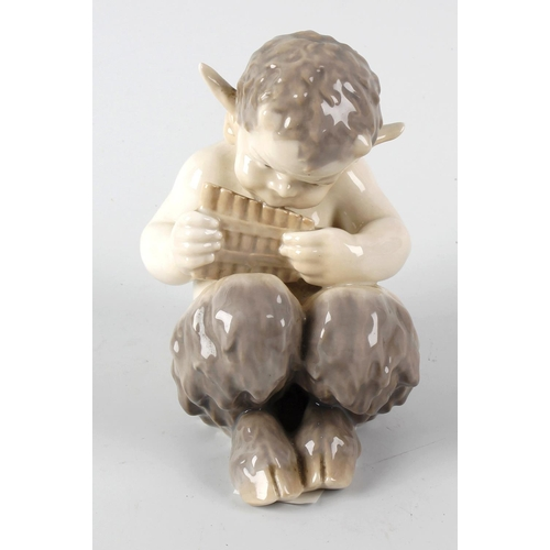 32 - A Royal Copenhagen figure, modelled as the infant Pan playing his pipes, with marks to base, No. 173...