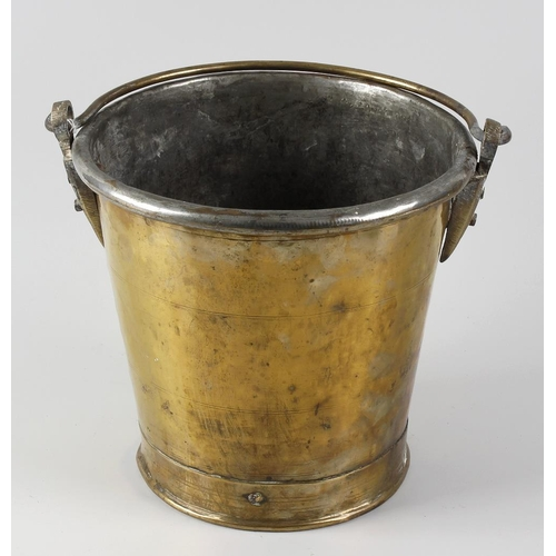 323 - A Georgian brass bucket, of typical tapered form, with banded body, 9 high, 9 diameter.  <br>With ge...