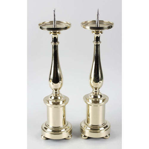 326 - A pair of 19th century brass pricket candlesticks, the circular indented drip trays, above knopped a...
