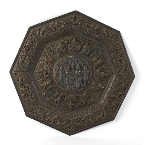 328 - An Indian copper alloy plate, of octagonal form, the whole with raised decoration, having central ci...
