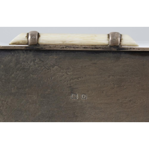 336 - An Art Deco hallmarked silver cigarette box, of rectangular form, having engine turned body raised o...